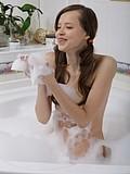 Skinny teen posing in the bath tub