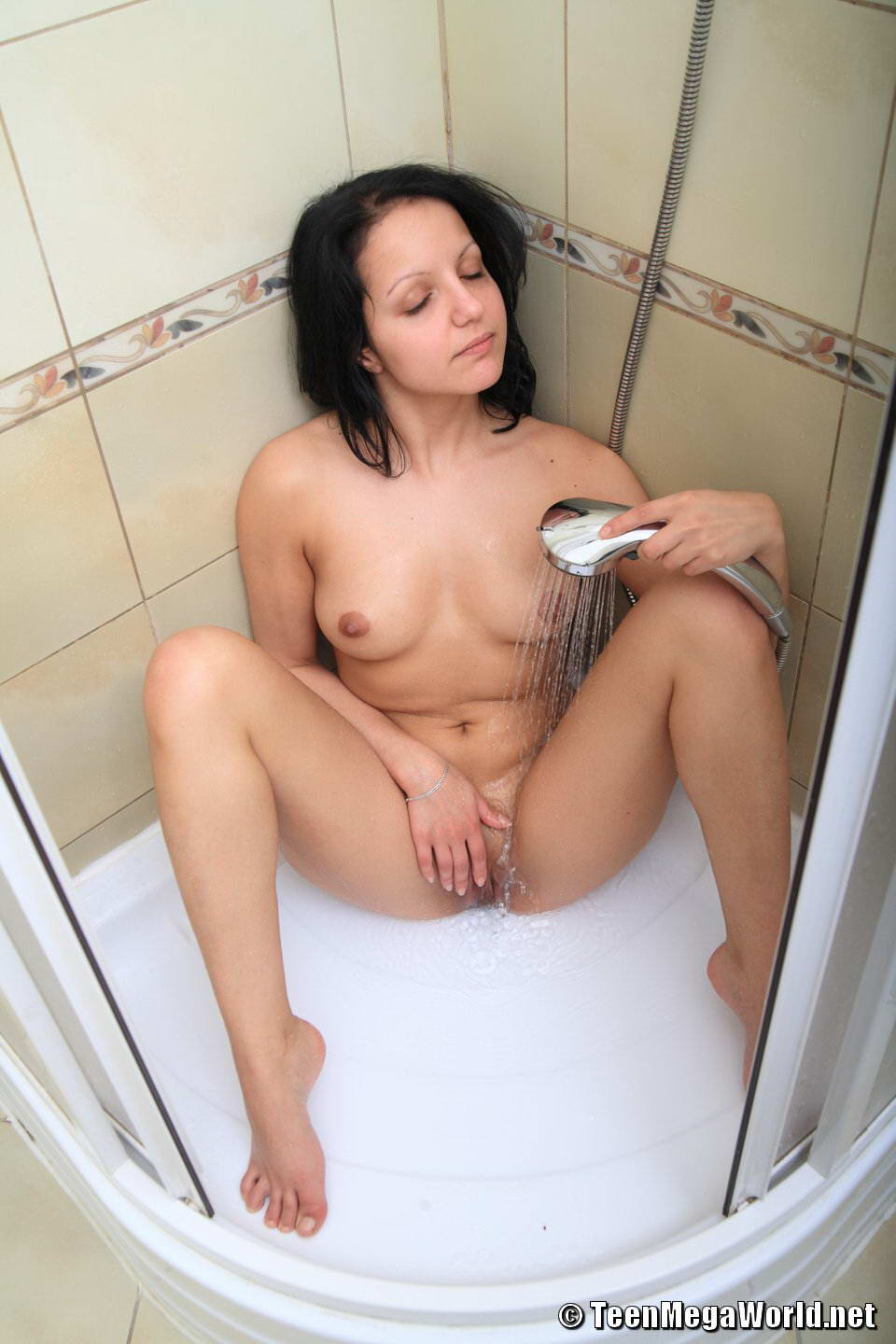 Brunette Teen Hottie Masturbates In A Shower - Picture 13